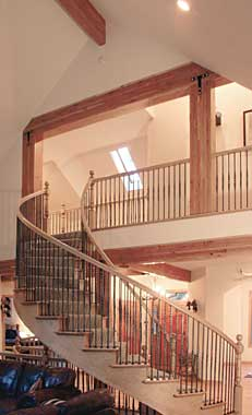 Picture of a finished curved staircase in the model P-801 house plan.